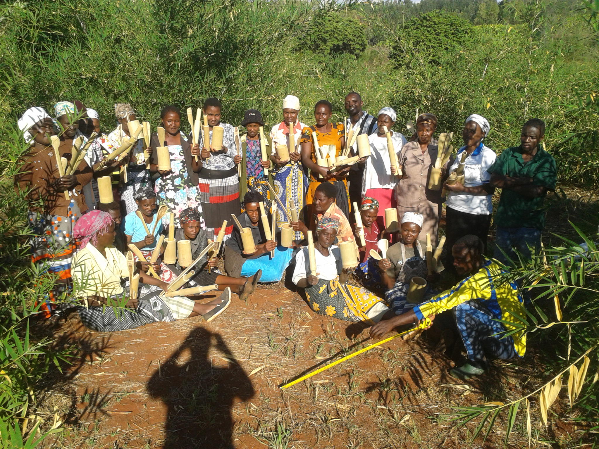 The women display some of the bamboo products they were trained to make
