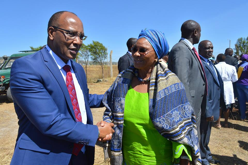Our Board Chair Ms. Marion Kamau shares a word with Nyandarua County Governor H.E. Francis Kimemia at the event