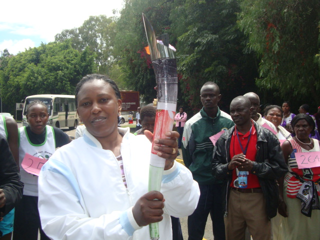 Rongai District Officer holding the Peace Torch to kick-start the Peace Marathon