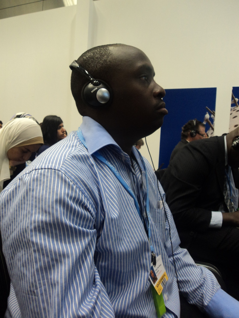 Charles Peter, Senior Project Officer on Climate Change listening through the UN Climate Conference
