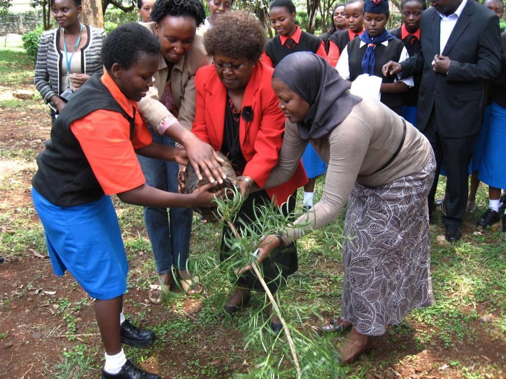 Starehe Girl from the Environmental Club, Senior Programme Officer Ms. Judy Kimamo, The Headteacher, Mrs. Margaret Wanjohi and GBM's Ag. Executive Director Ms. Aisha Karanja planting one of the ceremonial trees
