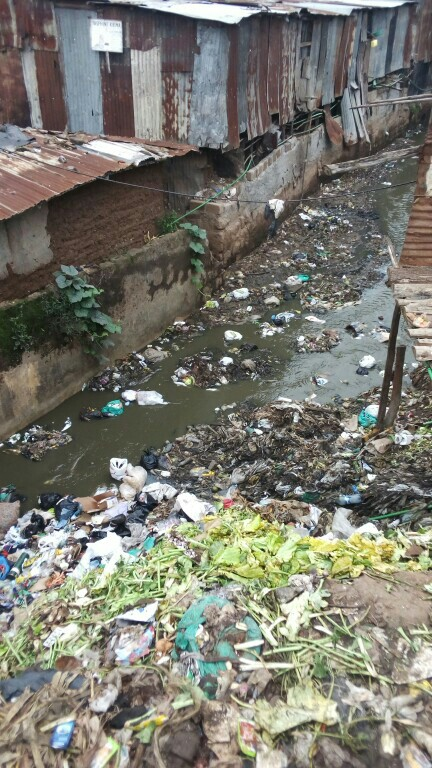 A section of Nairobi River passing through a slum
