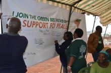 Participants at the event pledge their support for peace
