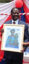 Raila Odinga unveils the new Wangari Maathai stamp