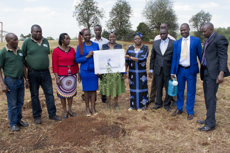 The Green Belt Movement team pose for a photo after planting Finley's tree